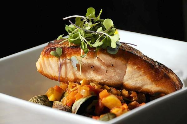 Pan-seared salmon with saffron aioli, fresh cockles, and chorizo ragout (potatoes, tomatoes, garlic, chorizo, clams.)
