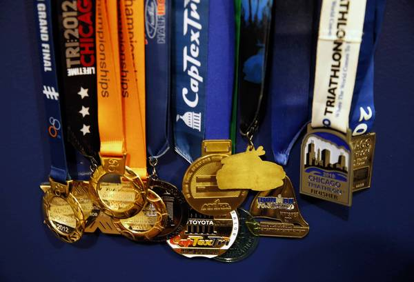 Melissa Stockwell's medals are displayed in her Bucktown home. Stockwell, a three-time world champion Paralympic triathlete, works at a prosthetics lab helping fit amputees with artificial limbs. The first female soldier to lose a limb in the Iraq war, she also founded a non-profit, dare2tri paratriathlon club.