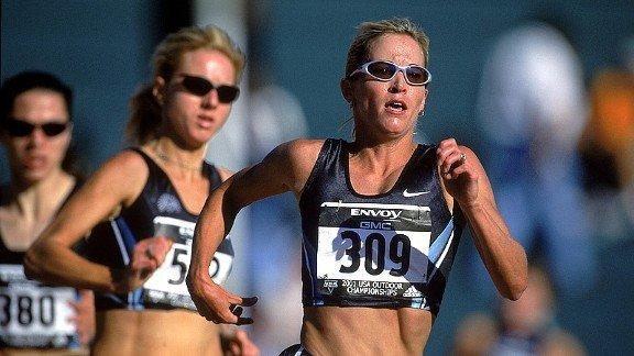 Suzy Favor Hamilton, right, runs in the 2002 U.S. Outdoor Track and Field Championships.