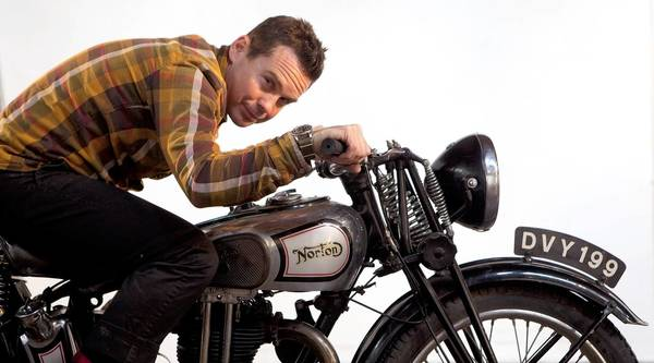 "Justin Kell, owner of Glory Motor Works, at his Glendale office/workshop. Glory Motors builds vintage motorcycles for the Hollywood movie industry. He Is shown on a 1935 Norton, Model 50 motorcycle, used in the movie ""The Master."""