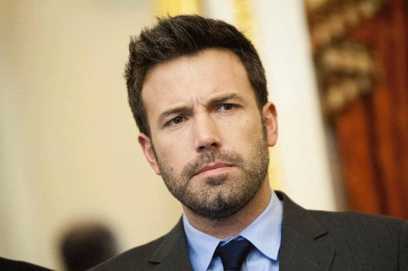 Ben Affleck poses for a photo during a meeting with members of the Senate Foreign Relations Committee in the U.S. Capitol on December 19, 2012 in Washington, DC.