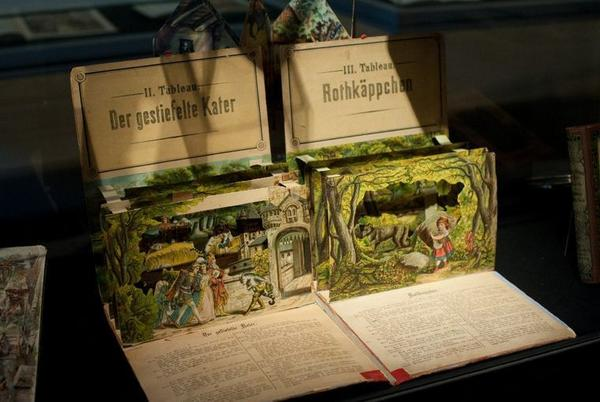 Pop-up fairy tale books from the 19th century sit in a glass case in the Brothers Grimm Museum in Kassel, Germany.