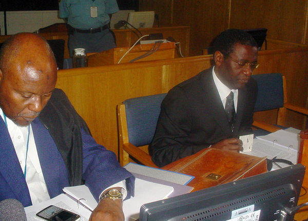 Former Rwandan Planning Minister Augustin Ngirabatware, right, sits next to his lawyer Cecil John Maruma during his first appearance before the International Criminal Tribunal for Rwanda in Arusha, Tanzania.