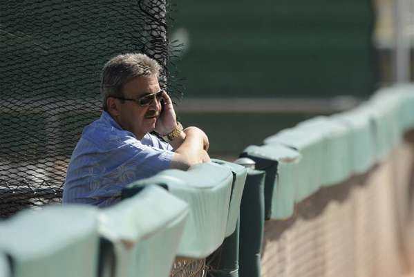 Ned Colletti's full head of hair apparently didn't help him in Yahoo Sports' David Brown's rankings.
