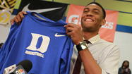 Jabari Parker leaned down from a podium crowded with microphones and pulled a bright blue Duke T-shirt from a backpack, providing a dramatic ending to the type of mystery that is becoming increasingly rare in high school recruiting.