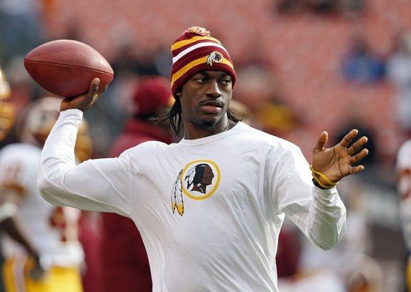 Washington Redskins quarterback Robert Griffin III tosses a ball on Dec. 16.