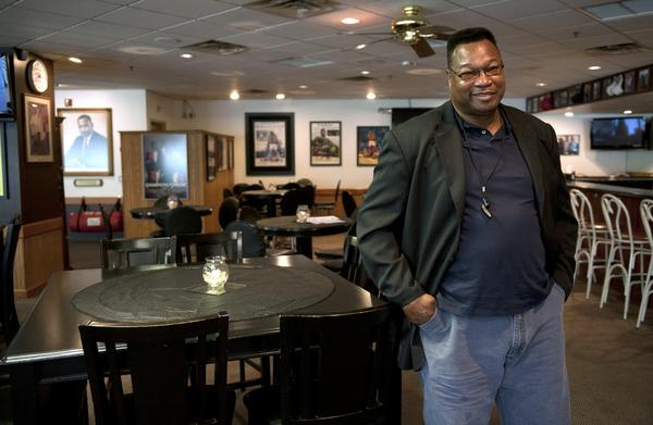 Larry Holmes poses in his new restaurant, Champs Corner in Easton on Thursday.