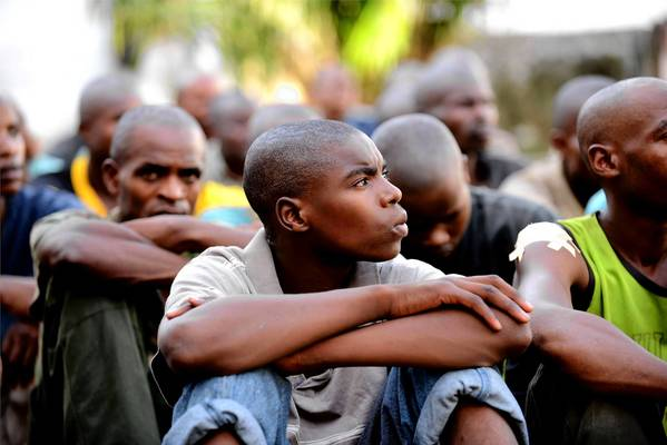 A youth identified as a 16-year-old corporal in the Rwandan armed forces sits with other prisoners in Kinshasha, capital of the Democratic Republic of Congo. The government accuses Rwanda of supporting rebels fighting in eastern Congo.