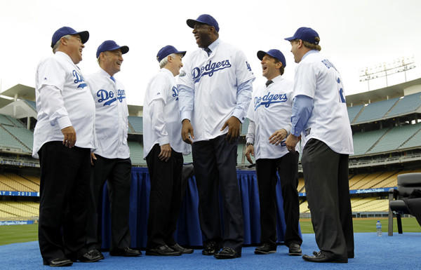 The new ownership group was all smiles -- as was most of Los Angeles -- as the era of Frank McCourt's ownership of the Dodgers and the legal turmoil surrounding the team's sale came to a close in May.