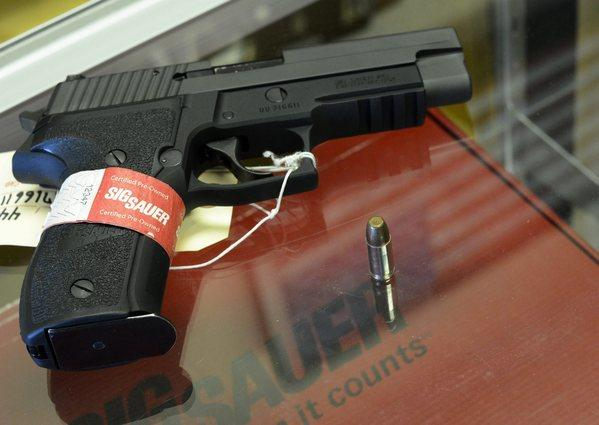 A Sig Sauer handgun is seen at CJI Guns store in Tucker, Ga.