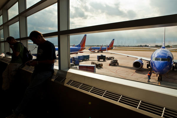 Passengers wait at boarding gates of Southwest Airlines at Midway Airport in Chicago in July 2012.