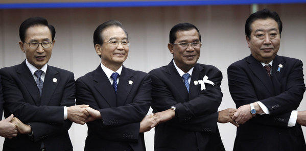 At the Assn. of Southeast Asian Nations summit in Cambodia last month, from left, South Korean President Lee Myung-bak, Chinese Premier Wen Jiabao, Cambodian Prime Minister Hun Sen and Japanese Prime Minister Yoshihiko Noda struck an amicable pose despite sharpening disputes over resource-rich islands along the East Asian coast. New leaders chosen since then in China, Japan and South Korea show no signs of putting the divisive territorial squabbles behind them.