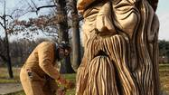 Dead trees in Druid Hill Park are carved into sculptures