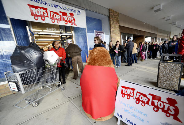 A long line forms in front of the entrance to the annual Salvation Army/Toys for Tots giveaway program on Thursday.