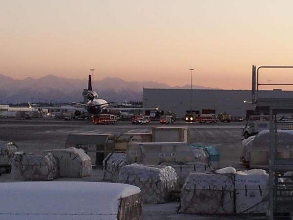 Fire trucks and emergency vehicles converged Thursday on the FedEx sorting facility at Ted Stevens Anchorage International Airport, after two people were taken to the hospital and two others were treated at the scene. The facility was evacuated for about an hour as authorities searched it for hazardous materials, but none were found.