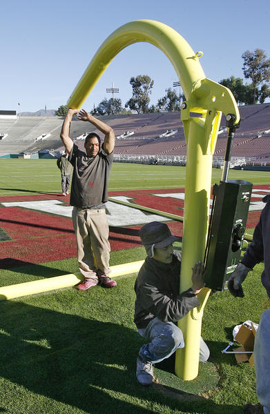 The goal post, by First Down Football Products, is assembled by Rose Bowl Operating Company crew members at the Rose Bowl in Pasadena on Thursday, December 20, 2012. Everything that goes into preparing for the upcoming Rose Bowl football game takes place on a schedule, behind the scenes, so the experience for all who attend, including fans, players, coaches, and other guests, is safe and fantastic.