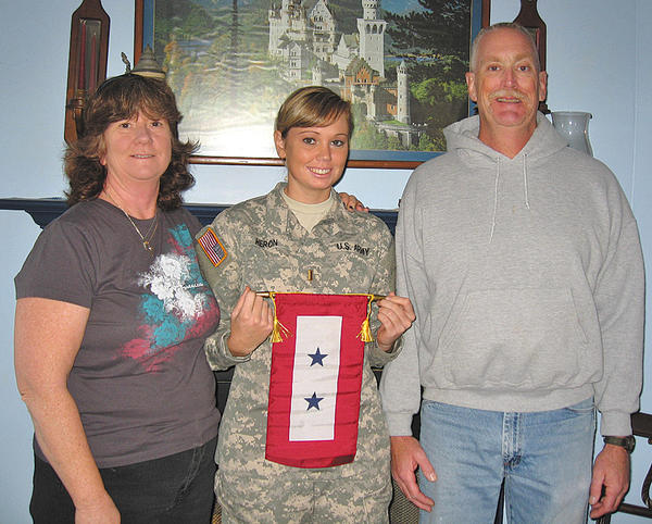 Melanie, Sabrina and Carl Heron show the Blue Star Service Banner given to the family by Antietam Unit 236, Sharpsburg American Legion.