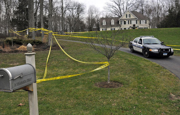 Police tape surrounds the home of Nancy Lanza, who was killed by her son, Adam Lanza. Adam Lanza also killed children and others at Sandy Hook Elementary School in Newtown, Conn.
