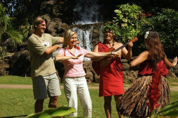 Visitors learn hula at the Polynesian Cultural Center on Oahu's North Shore.