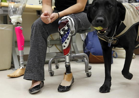 Melissa Stockwell works with her service dog Jake on Tuesday, Dec. 4, 2012 in the Scheck and Siress lab at UIC.