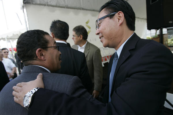 Chris Pak, right, is seen talking with Herb Wesson in 2006.