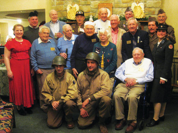World War II veterans and a number of others attended a Roundtable Christmas party were dressed in uniform in honor of the occasion.
