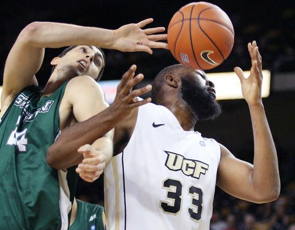 UCF forward Keith Clanton (33) Stetson forward Liam McInerney (left) battle for the ball during the Stetson at UCF basketball game at the UCF Arena in Orlando on Thursday, December 20, 2012.