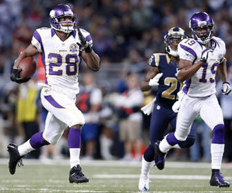Minnesota Vikings running back Adrian Peterson runs 82 yards for a touchdown Sunday against the St. Louis Rams. With two games remaining, Peterson is 293 yards away from tying Eric Dickerson's single-season rushing yards record.