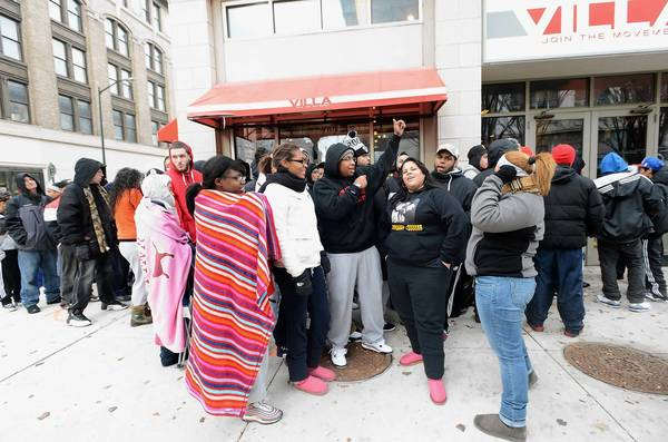 Customers wait in line outside the Villa clothing store at 8th and Hamilton Streets in Allentown shortly before tickets were passed out for the new Air Jordan Retro 11 Breds sneaker. The sneakers go on sale Friday morning.