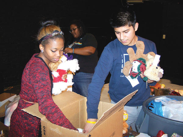 Franesa Brown, left, and Edgar Perez load teddy bears into boxes Thursday for their journey to Newtown, Conn. Franesa and Edgar are students at Martinsburg (W.Va.) High School.