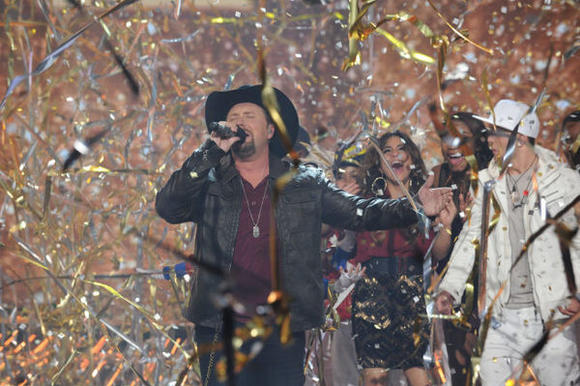 'The X Factor' season two winner Tate Stevens performs in the finale