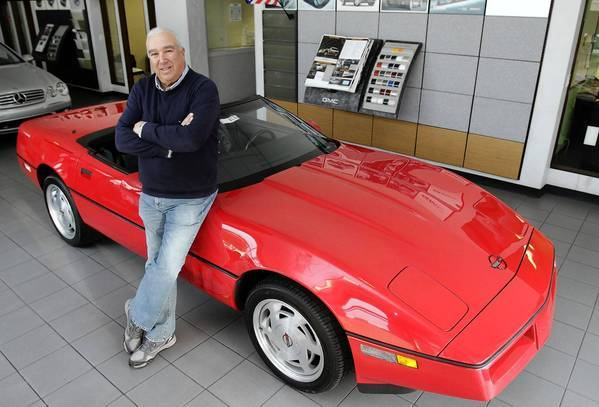 Corky Rice is shown with the Corvette that was parked in a storage locker since it was stolen in 1989.