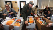 500 steelworkers turn out to receive United Way holiday meals