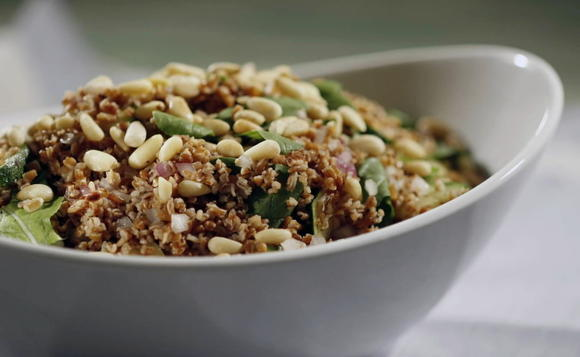 Bulgar salad with arugula, zucchini and pine nuts