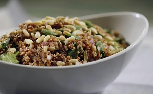 Bulgar salad with arugula, zucchini and pine nuts
