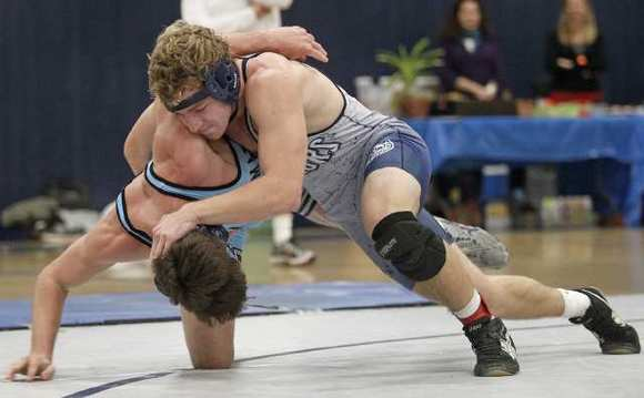 Newport Harbor High's James Pilz, right, wrestles Corona del Mar's Kaden Ebbinga during a Battle of the Bay match on Thursday. Pilz won.