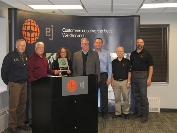 Emmet County Recycling Director Elisa Seltzer presents the program's 2012 Recycler of the Year award to EJ (formerly East Jordan Iron Works) represented by (left to right) Mark Aepelbacher, Gary Pangborn, Tom Teske, Todd Ingalls, Richard Hodge and Mark Lefevre.