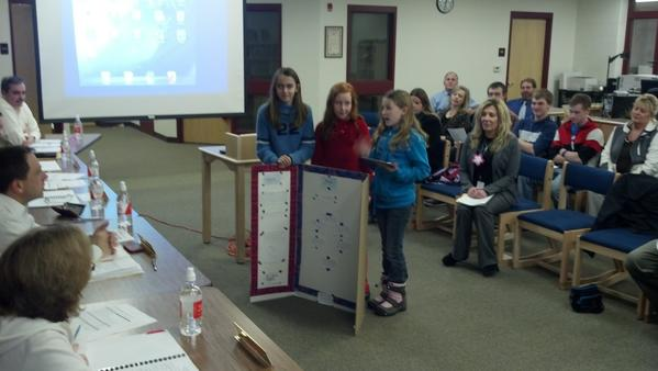 East Jordan Middle School fifth grade students present information to the district's Board of Education about how they are able to use iPads in the classroom.