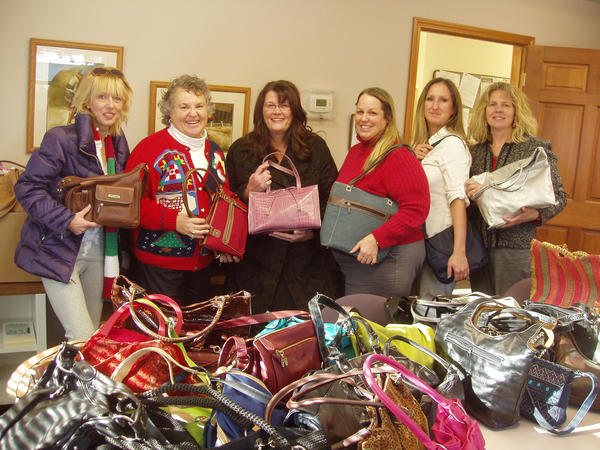 Women's Resource Center of Northern Michigan receives a donation of fully-stocked purses from Handbags of Hope to benefit domestic abuse survivors. Shown with the handbags are (from left) Jackie Bobcean of Handbags of Hope; Jan Mancinelli, Women's Resource Center executive director; Justine Stone of Handbags of Hope; Deb Smith, women's center assistant director; Leslie Turovaara, Secretary; and Gail Kloss, finance director.