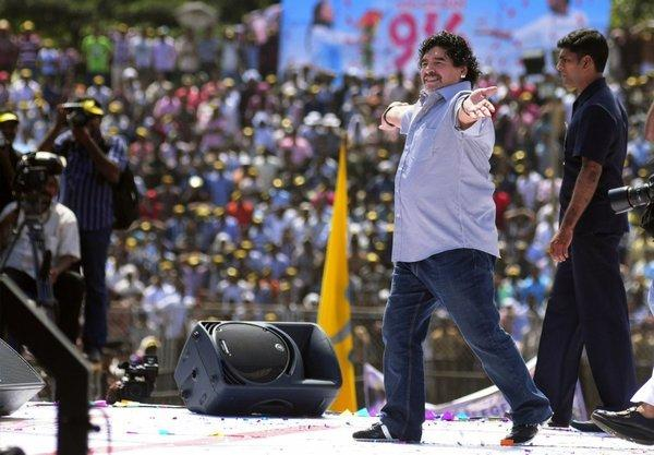 Diego Maradona entertains fans in Kannur, India.