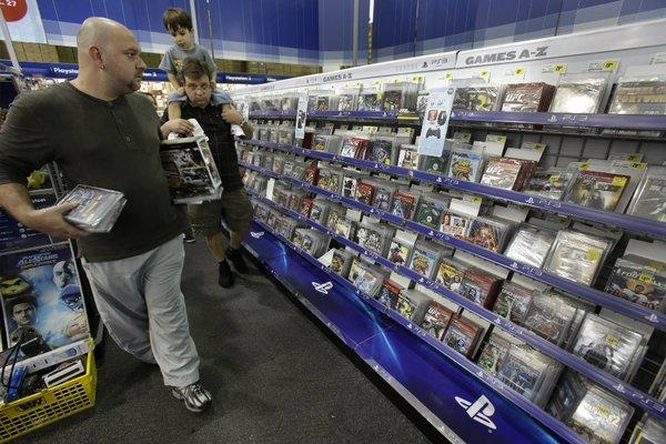 Holiday-season shoppers look for bargains in the video game section of a Best Buy store in Orlando, Fla.