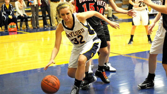 GAYLORD SENIOR Stephanie Buttrick drives the lane during the Blue Devils' one-point loss to Cheboygan Tuesday.