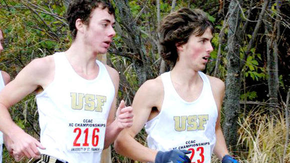 2009 ST. MARY GRADUATE Michael Topp (right) was a member of the national champion St. Francis cross-country team this season.