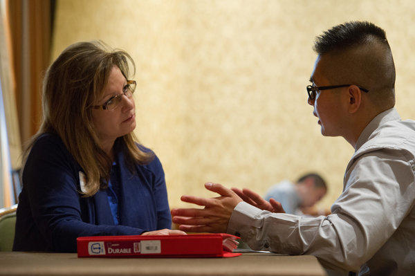 California's unemployment rate fell to 9.8% in November, the lowest in almost four years, the U.S. Bureau of Labor Statistics said Friday. Above, Shari Eknoian, human resource manager for RiteAid Corp. listens to job seeker Ryan Truong during a job fair in San Jose this month.