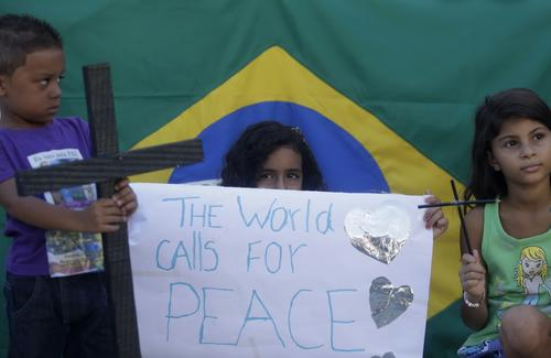 Children attend a demonstration in tribute to the victims in Rio de Janeiro