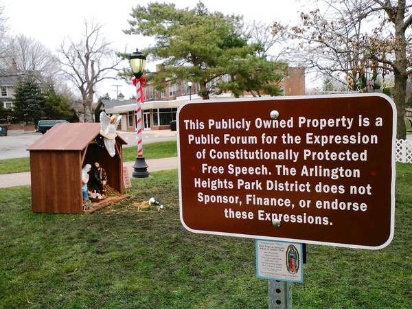 "Outside the perimeter of a Nativity scene set up at North School Park, the Arlington Heights Park District declares that the agency does not ""sponsor, finance or endorse"" the ""Constitutionally protected free speech."""
