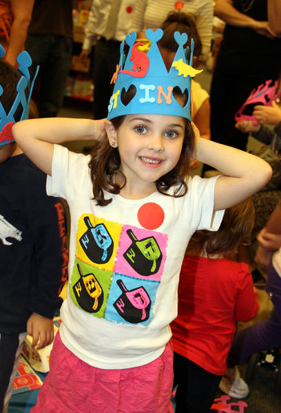 Zoe Englander shows off her decorated crown, which she made at a community Hanukkah celebration on Dec. 13 at Barnes & Noble Booksellers located in Plantation. The event was co-sponsored by PJ Library, Ramat Shalom Synagogue and Temple Kol Ami Emanu-El. PJ Library is a Jewish family engagement program implemented on a local level throughout the U.S. in the form of free, quality Jewish children's literature and music mailed to families across the continent on a monthly basis. For more information, visit www.PJLibrary.org.