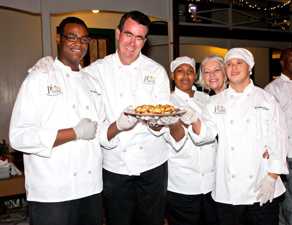 Chefs Arielle Weekes, left, Joe Aycock, Kamaria Fowler-Henderson, Lenore Nolan Ryan and Dean Bergman at The Traveling Plate's holiday-themed event, which took place Nov. 28 at the Stranahan House.
