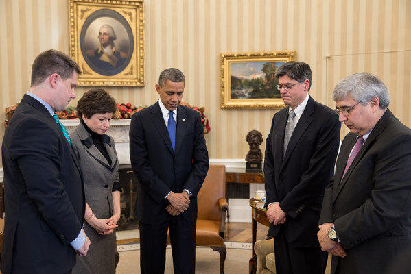 President Obama pauses during a meeting with Director of Communications Dan Pfeiffer, senior advisor Valerie Jarrett, Chief of Staff Jack Lew and Pete Rouse, counselor to the president, to observe a moment of silence in the Oval Office.