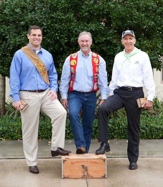 "Britton Core, left, Mark Simpson and Dale Hendrick proudly display their Boy Scout honors while promoting the Boy Scouts of America's fourth annual ""Boy Scouts Sportsman's Grand Jamboree,"" which will take place Feb. 8 at Palm Beach Motorcars."